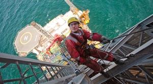 Oil rig worker climbing - photo - September 2017