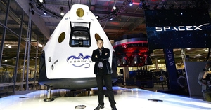 Elon Musk standing in front of SpaceX capsule - photo - December 2017