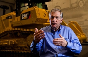 Caterpillar CEO speaking in front of construction vehicle - photo - January 2018