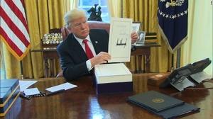 Trump's signed tax bill - photo - January 2018